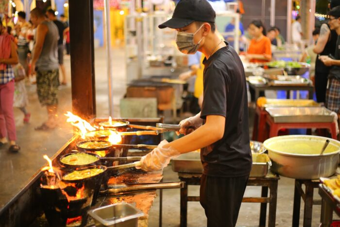A man is cooking at food court
