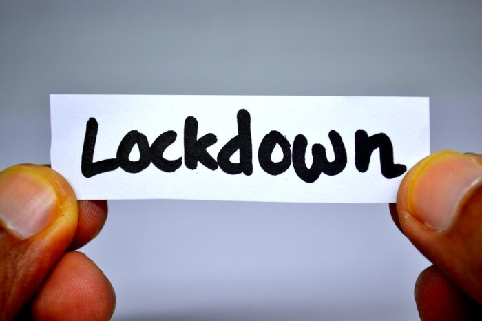 Holding the sing of Lockdown